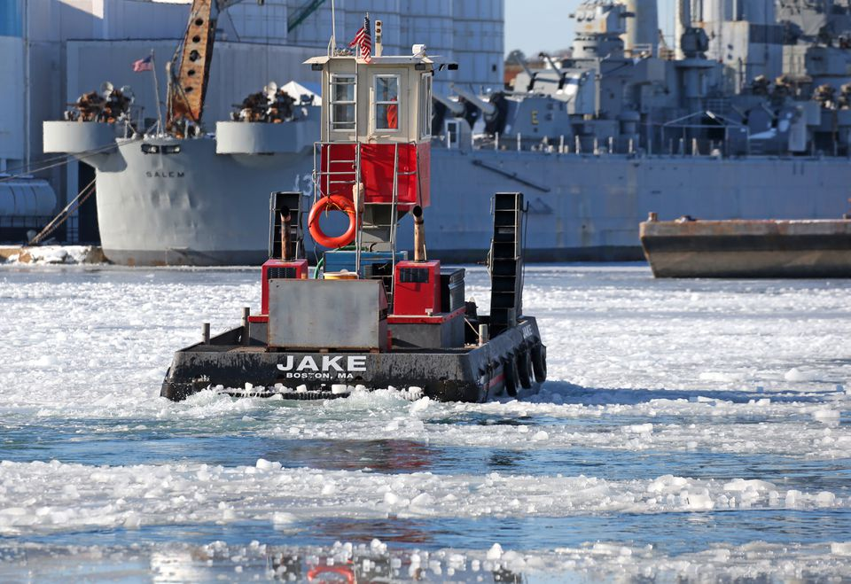 A small tug in Weymouth broke up ice in the Fore River.
