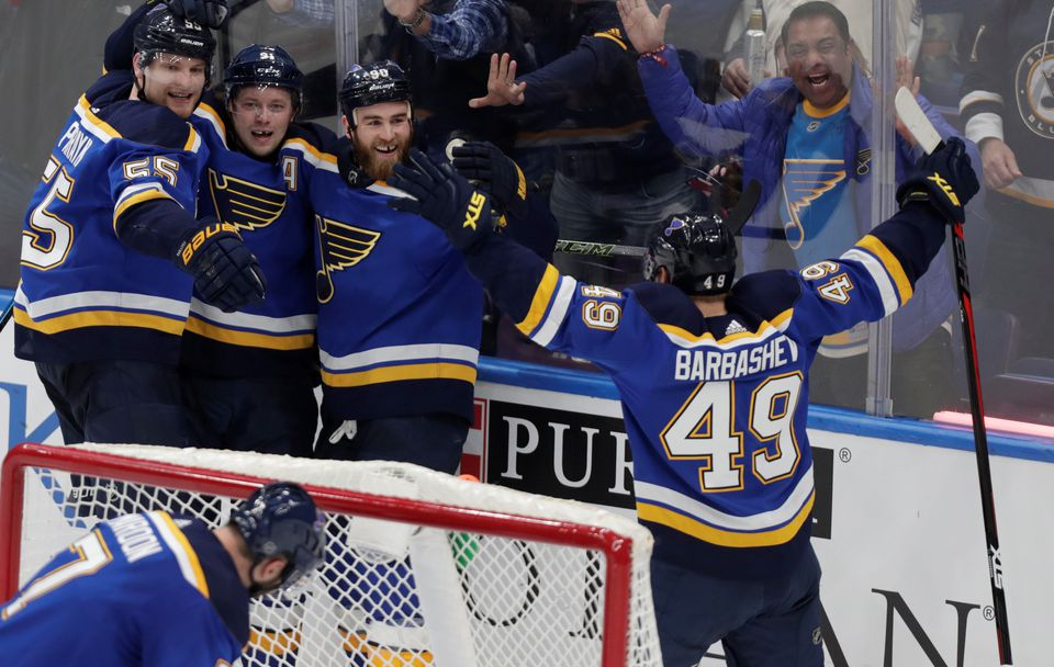 Ryan O'Reilly (third from left) celebrates with teammates after scoring in overtime to beat the Maple Leafs.