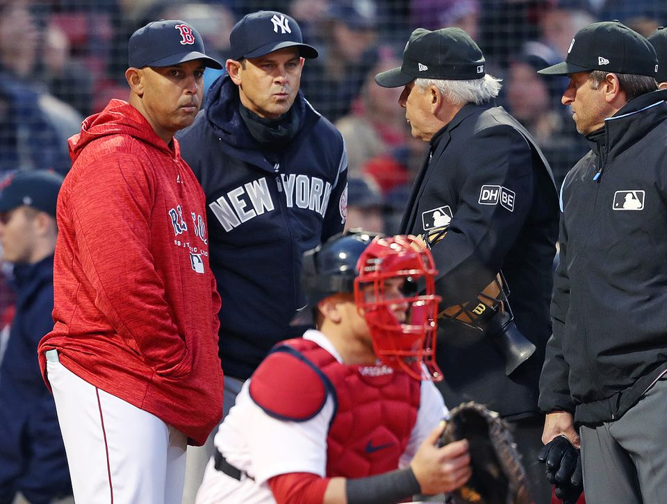 Despite having to manage their way through injuries to key personnel, Boston Red Sox manager Alex Cora (left) and New York Yankees boss Aaron Boone have had amazing first-year runs.