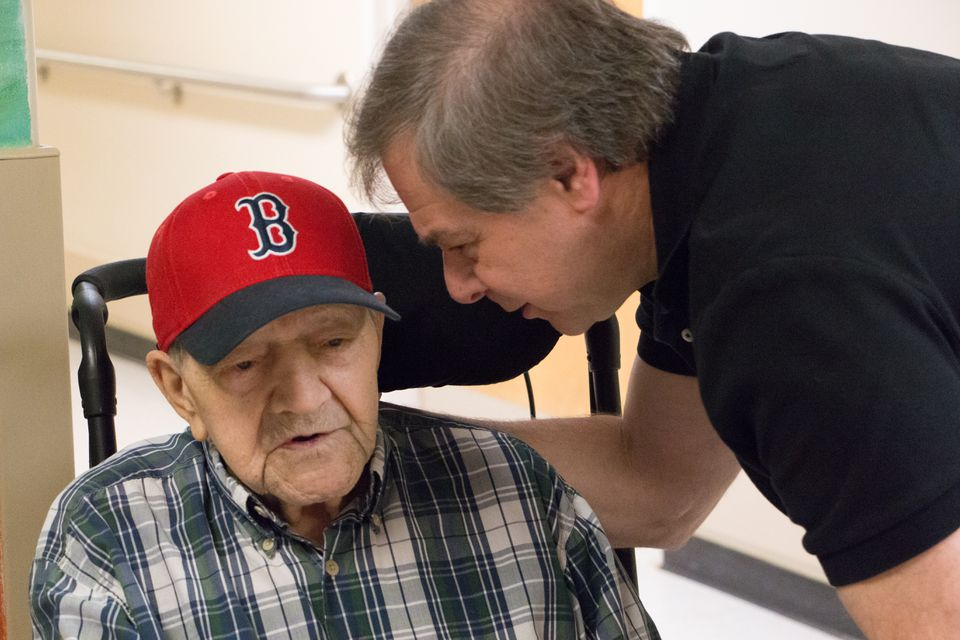 """Nick Bonanno with his father, Russ, 94, at the Bedford VA. Nick said he was upset that an aide was let go after she reported rough treatment of his father. """"She made a real effort to engage the vets,'' he said."""