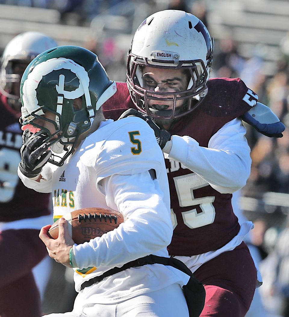 Lynn English's Mason Jones stopped Lynn Classical's Marcus Tucker, but got called for the facemasking penalty.