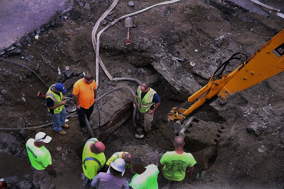 Workers repaired a broken water main at Mount Auburn and JFK streets in Harvard Square.