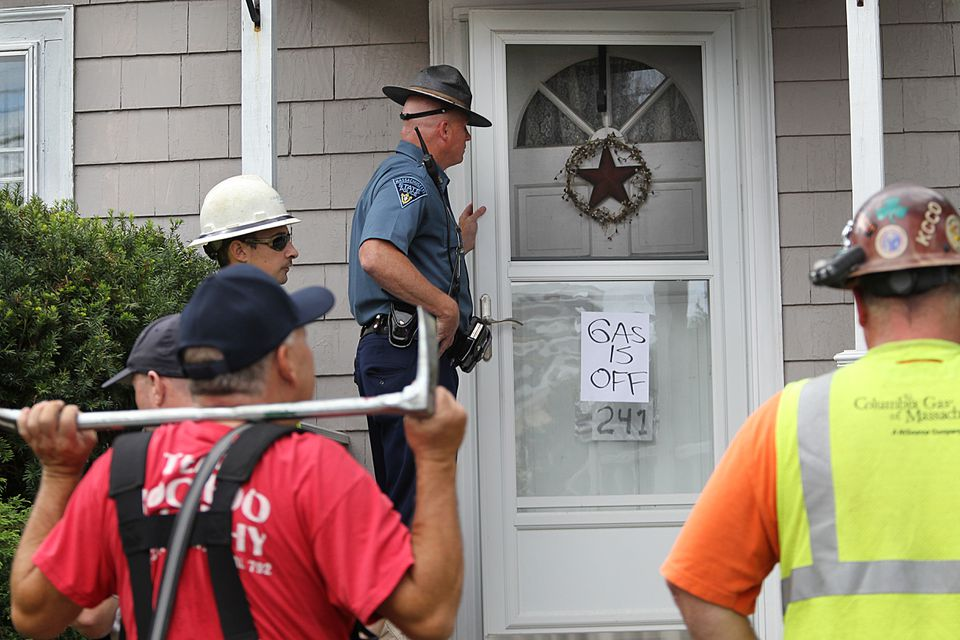 Quincy firefighters, police officers, and Columbia Gas workers went house by house on Pleasant Street in North Andover.