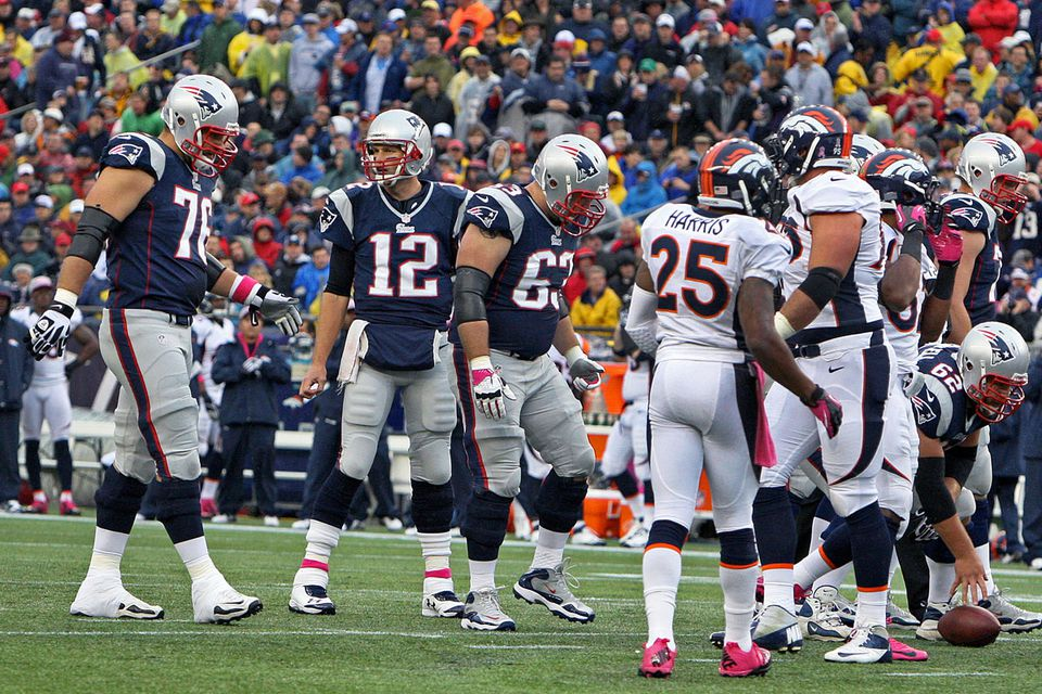 Tom Brady calls out the play — with center Ryan Wendell all ready to roll — as the Patriots' no-huddle offense lines up quickly while the Broncos' defense attempts to adjust.