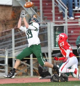 Brendan Hill of Mansfield, hauls in a pass from QB Kyle Wisnieski against Waltham in Div. 2 state semifinals in November. He is ahead of schedule after injuring his knee on Thanksgiving last fall and is expected to be ready for the start of practice.