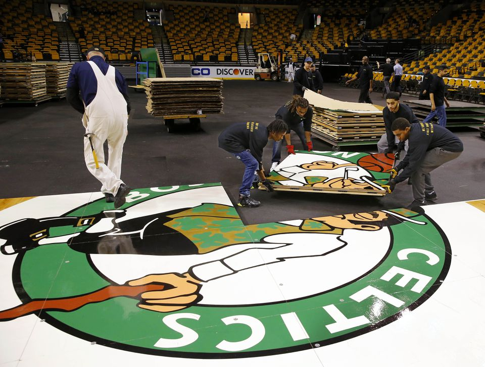 TD Garden Bull Gang members put down the court in between a Bruins and Celtics game in 2015.