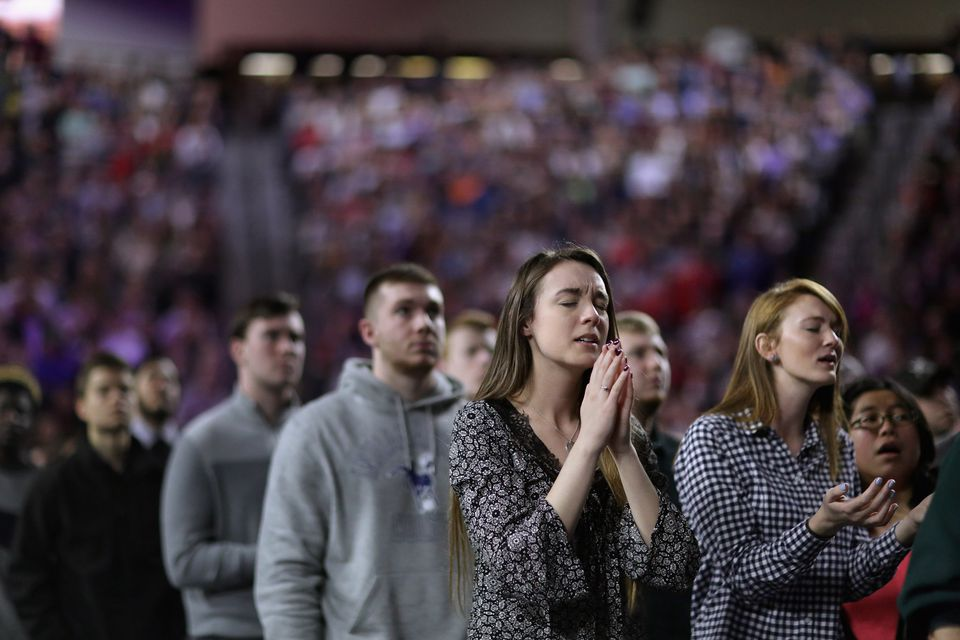 Supporters sing before then-candidate Donald Trump delivers a convocation at Liberty University in Lynchburg, Va., in 2016. Evangelicals have been among Trump's strongest backers.