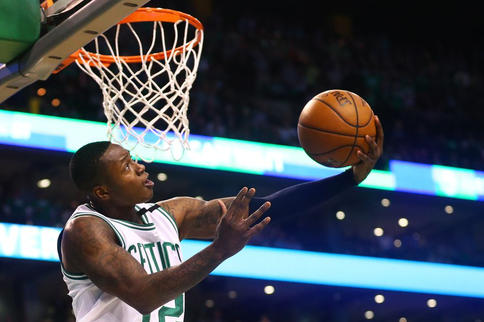 b690976bc Terry Rozier of the Boston Celtics takes a shot against the Washington  Wizards at TD Garden
