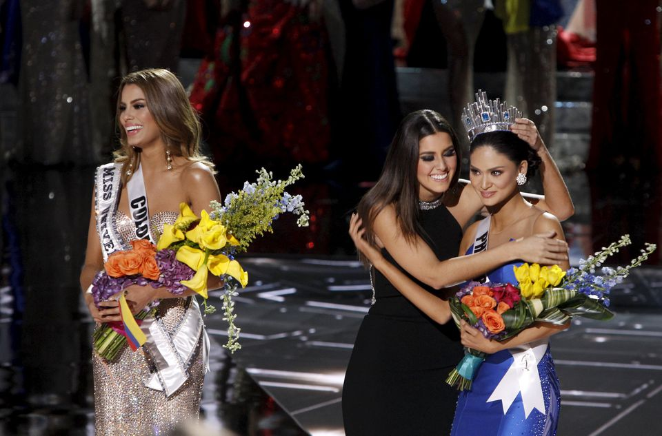 Miss Universe 2014 Paulina Vegas (center) hugged winner Miss Philippines Pia Alonzo Wurtzbach as Miss Colombia Ariadna Gutierrez (left) stood by during the 2015 Miss Universe Pageant in Las Vegas, Nevada.
