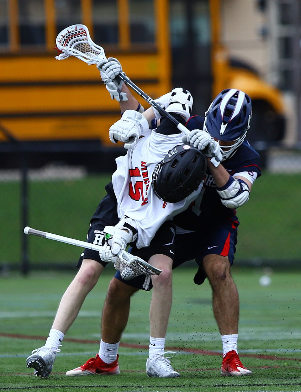 Hingham's Pat Doyle gets tangled with Lincoln-Sudbury's Braden O'Connell during Saturday's final in the Coaches Challenge Cup at Winchester High.