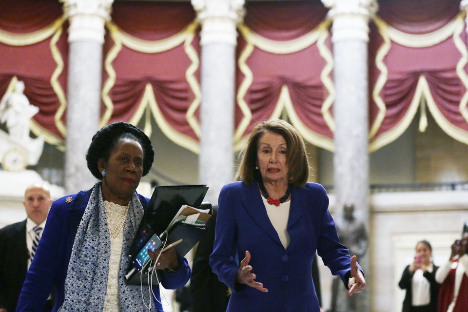Speaker of the House  Nancy Pelosi walked with Representative Sheila Jackson-Lee, Democrat of Texas, to the House chamber for a vote on President Trump's emergency declaration.