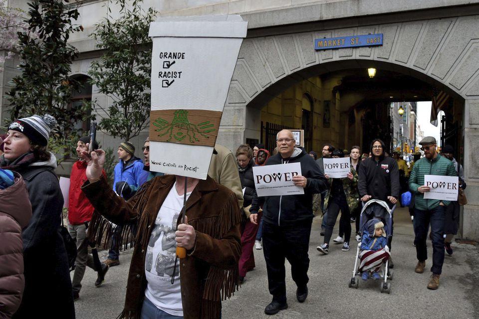 Protestersin Philadelphia rally against the arrest of two black men at a Starbucks.