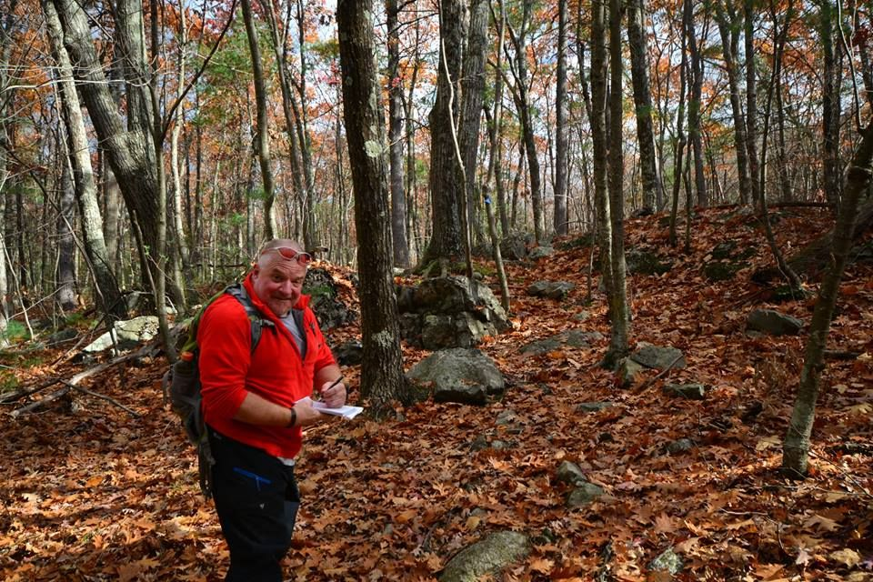 Guidebook author Lafe Low of Franklin taking notes while hiking through the forests of Cedar Hill in Northborough.