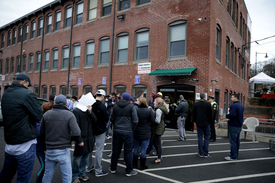 Customers line up to make purchases of recreational marijuana products at ATG in Salem.