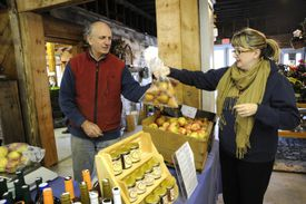 Anthony Levick, of Hill Orchard, sold pears to Lynn Neild, right, at the Westford Farmer's Market.