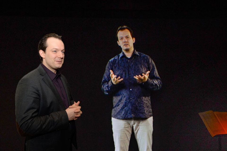 BSO music director Andris Nelsons (far left) and his holographic image.