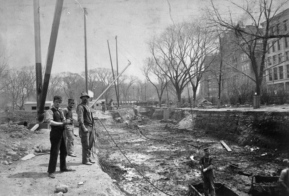 Workers overlooking the subway construction on Boston Common in April 1895.