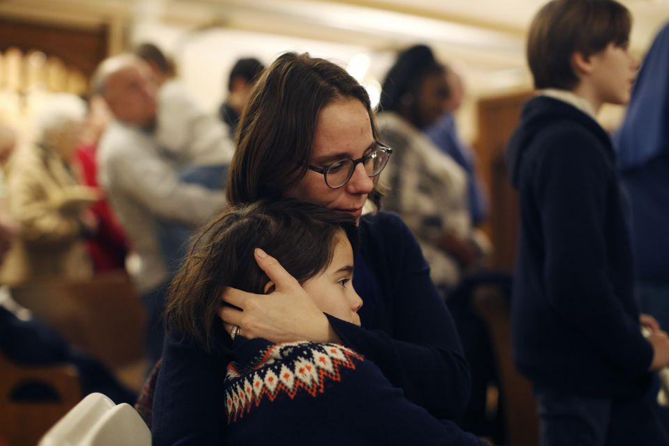 Marguerite Lelievre and her daughter Madeleine embraced the service.