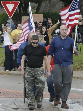 Anti-Muslim supporters walked across the street from counterprotestors outside a mosque in Texas, Dec. 12.