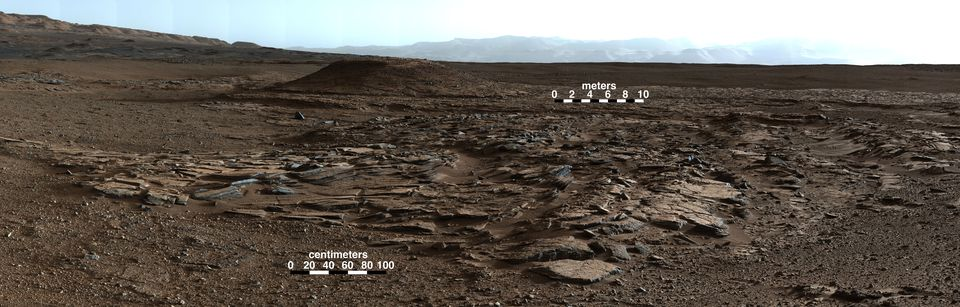 A mosaic image made from photographs taken by the Mast Camera on NASA's Curiosity Mars rover looks to the west of the Kimberley waypoint on the rover's route to the base of Mount Sharp. The mountain lies to the left of the scene.