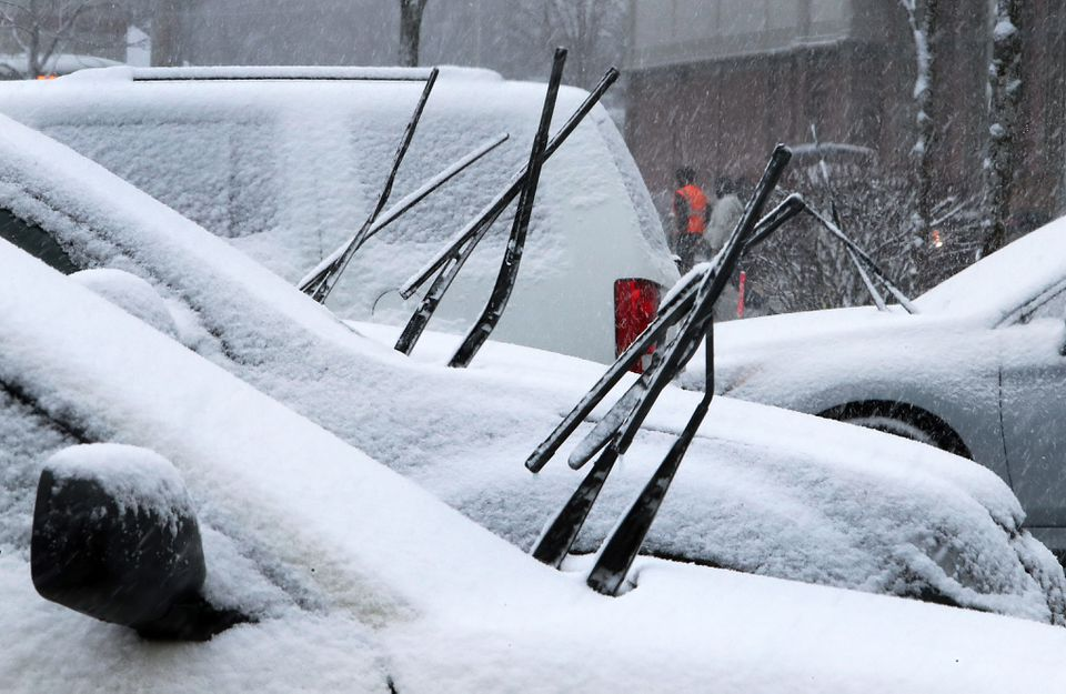 Snow began to accumulate Wednesday afternoon in the parking lot of a Market Basket shopping plaza near downtown Fitchburg.