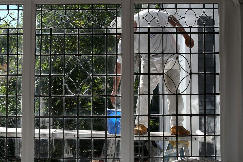 Painter works on home in Worcester's West Side.