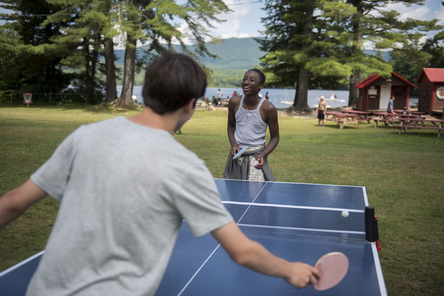 Long-time friends Jacob Smith, right, and David Falis played ping-pong during a sunny morning.