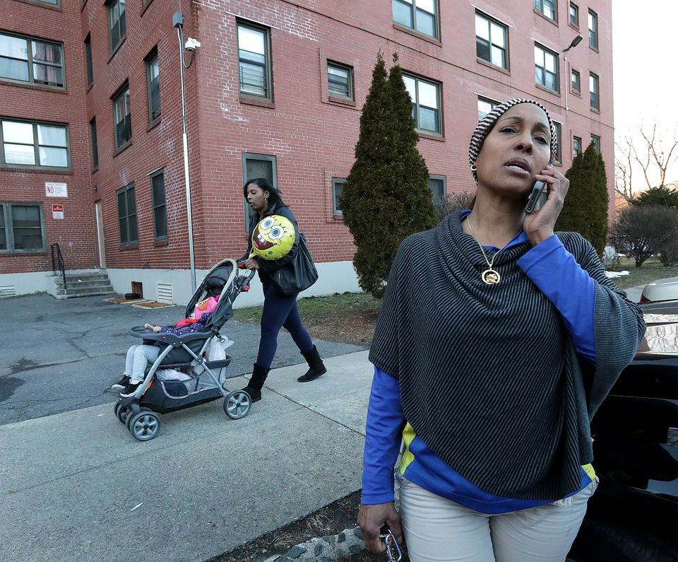 Yocasta Osorio outside her home at the Mildred C. Hailey Apartments in Jamaica Plain. Boston housing officials are seeking a private developer to help rebuild the development.