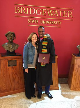 Cheryl Opper and Lorenz Marcellus at graduation from Bridgewater State University on May 13.