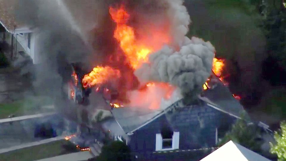 Flames consume a home in Lawrence on Sept. 13, following a gas leak explosion, one of several that devastated neighborhoods in Lawrence, Andover, and Norther Andover.