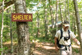 Paul Clifford, 46, of Portland, Maine, hikes out from Old Hermit Shelter, built in June in Nash Stream Forest by Cohos Trail volunteers.