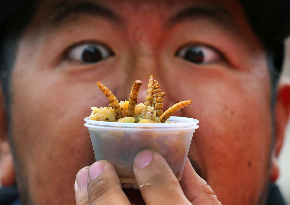 Voravut Ratanakommon of Boston looked ate a cup of fried rice with mealworms.