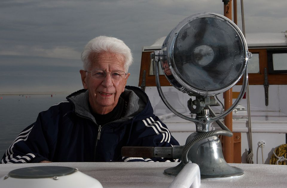 Mr. Fitzgerald posed next to the spotlight he manned on the night of the rescue in 1952 aboard motor lifeboat CG36500.