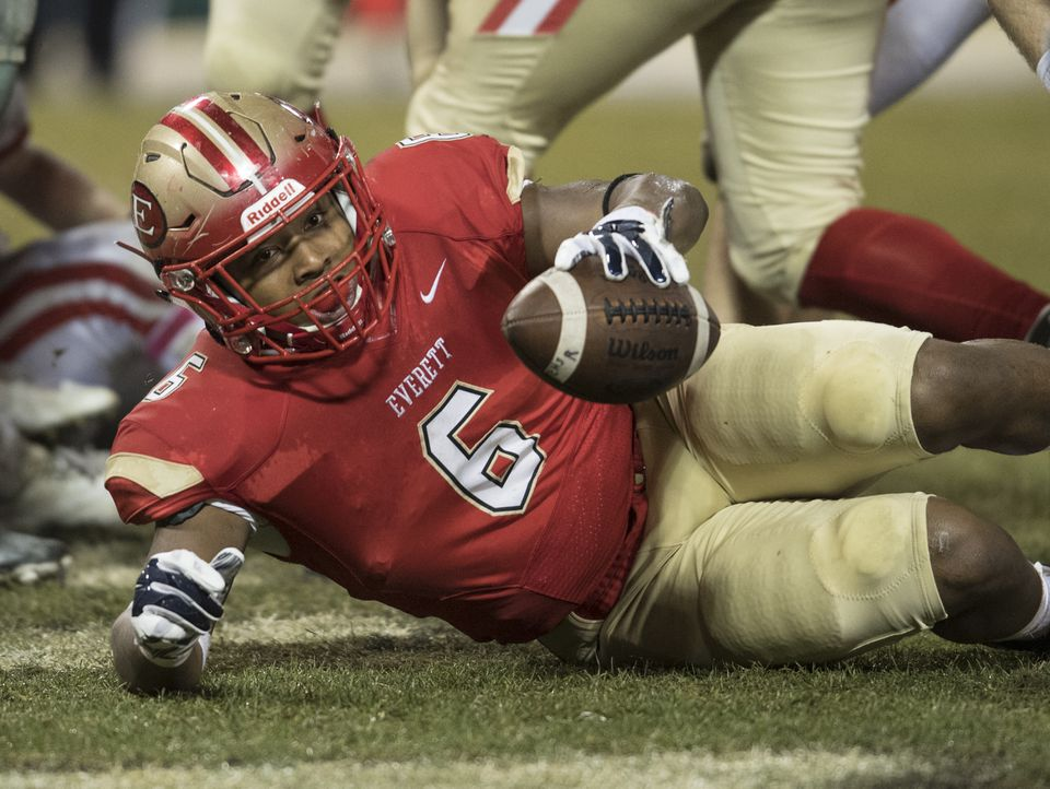 Kevin Brown landed in the end zone for one of his three touchdowns for Everett in Wednesday's 36-20 win over Masconomet Regional at Fenway Park.