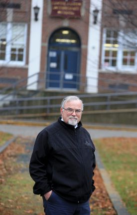 Paul Donlan in front of Gates Intermediate School in Scituate. His job is to oversee the school's compliance with federal asbestos laws.