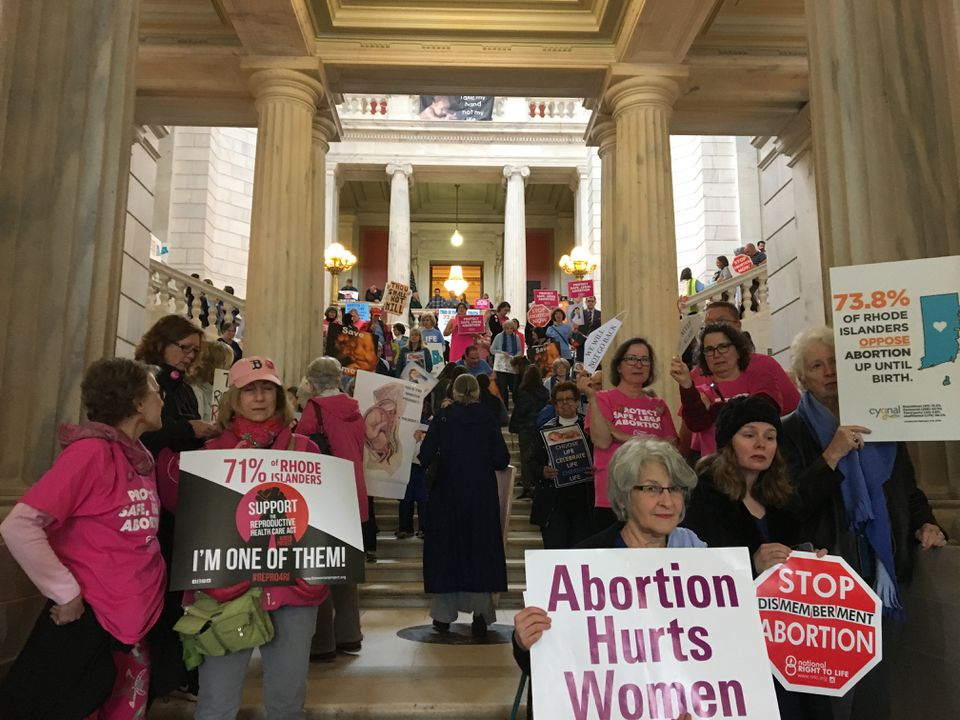Advocates and opponents of an abortion-rights bill filled the Rhode Island State House rotunda on Tuesday before the Senate Judiciary Committee vote.
