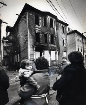 Neighbors looked at the burned-out Lowell house after the 1982 fire.