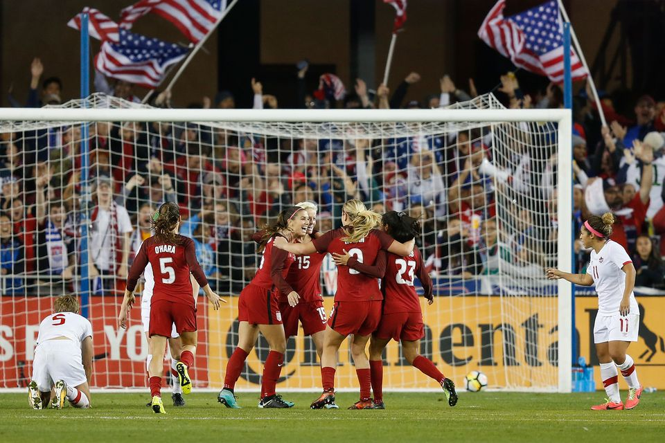 Alex Morgan is in the middle of a celebration after scoring a goal for the United States against Canada.
