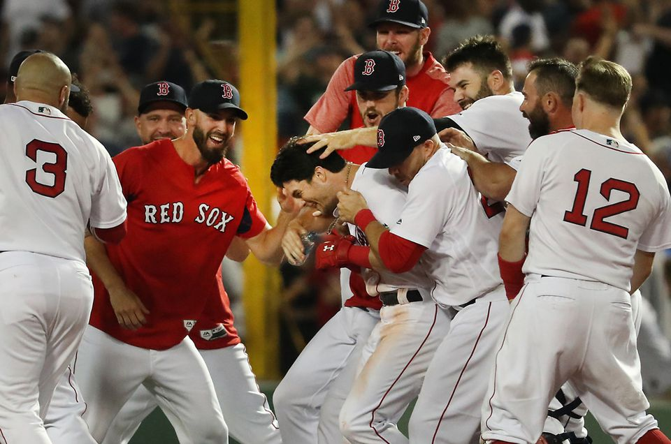 4a5e6b0dc Andrew Benintendi is surrounded by his teammates after his game winning  walk off hit against the