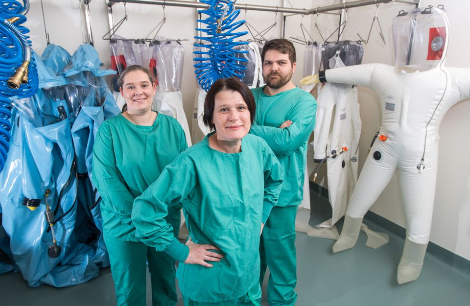 Judith Olejnik (left), Elke Mühlberger, and Adam Hume are ready to work at BU's new Biosafety Level 4 laboratory.