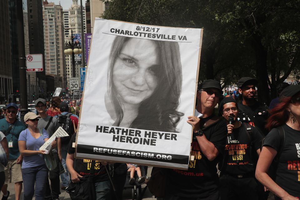 A demonstrator carries a sign remembering Heather Heyer during a protest Sunday in Chicago.