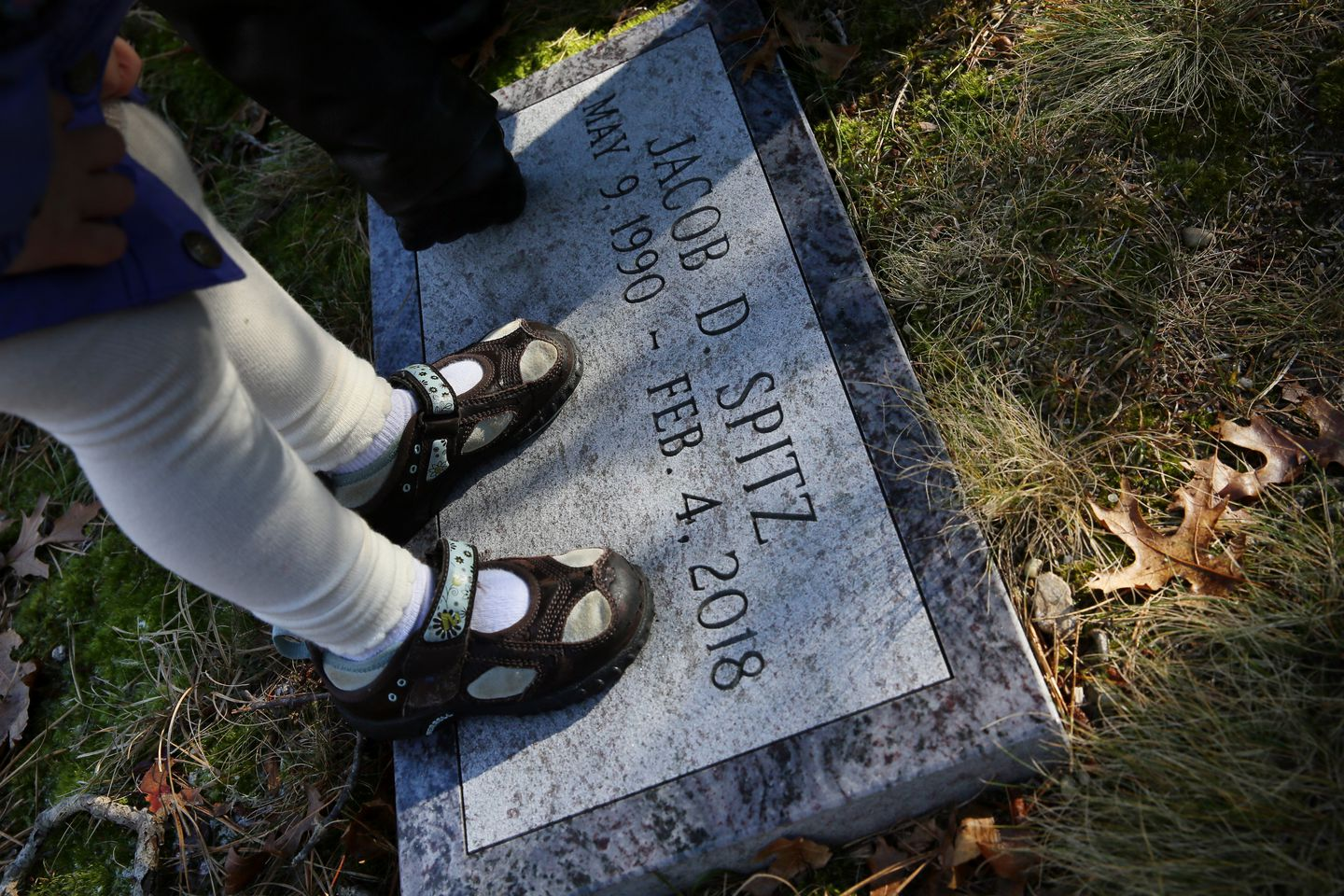 David Spitz and Diane DiGennaro took their granddaughter to the grave of her father, Jacob Spitz.