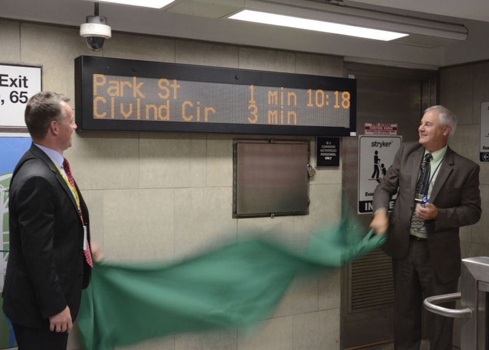 """MBTA Administrator Brian Shortsleeve (left) and General Manager Frank DePaola unveiled a new """"countdown"""" sign at Kenmore Station in August."""