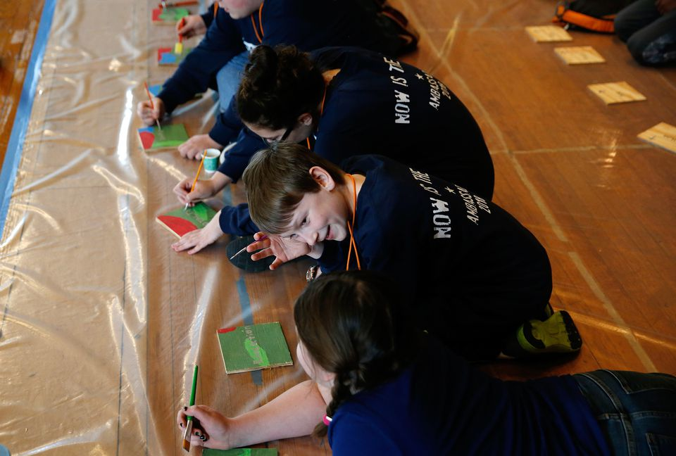 Ambassadors of Project 351 inscribed inspirational words onto a tile that will become part of a mural.
