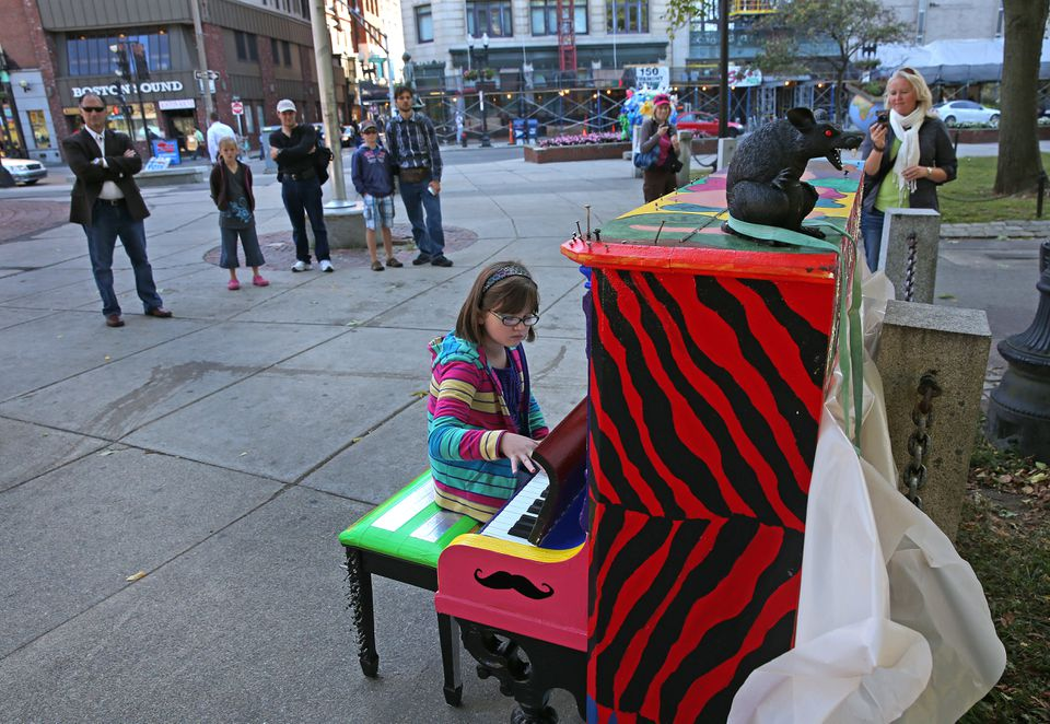 Brenna Krahwinkel, from Tenn., gathered a small audience as she played a piano on Boston Common in 2013.