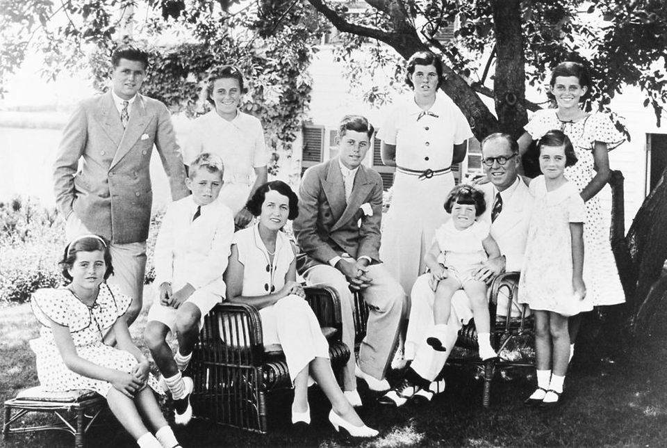 The Kennedy family in Hyannisport in 1934. Standing from left: Joseph Jr., Kathleen, Rosemary, and Eunice. Sitting: Patricia, Robert, Rose Kennedy, John, Edward in Joseph P. Kennedy Sr.'s lap, and Jean; Jean Ann Kennedy Smith, 88, is the only one in this portrait still living.
