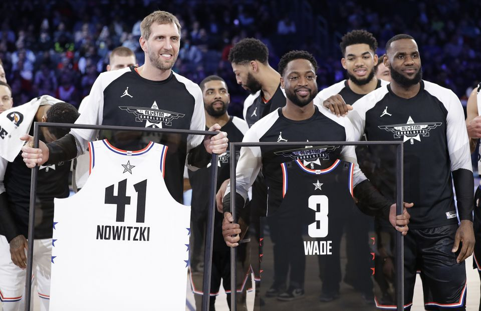 Dirk Nowitzki (left) and Dwyane Wade, playing in their final seasons, were honored at halftime.