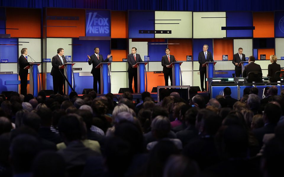 Ben Carson (third from left) spoke as Rand Paul, Chris Christie, Ted Cruz, Marco Rubio, Jeb Bush and John Kasich listened during a Republican presidential primary debate.