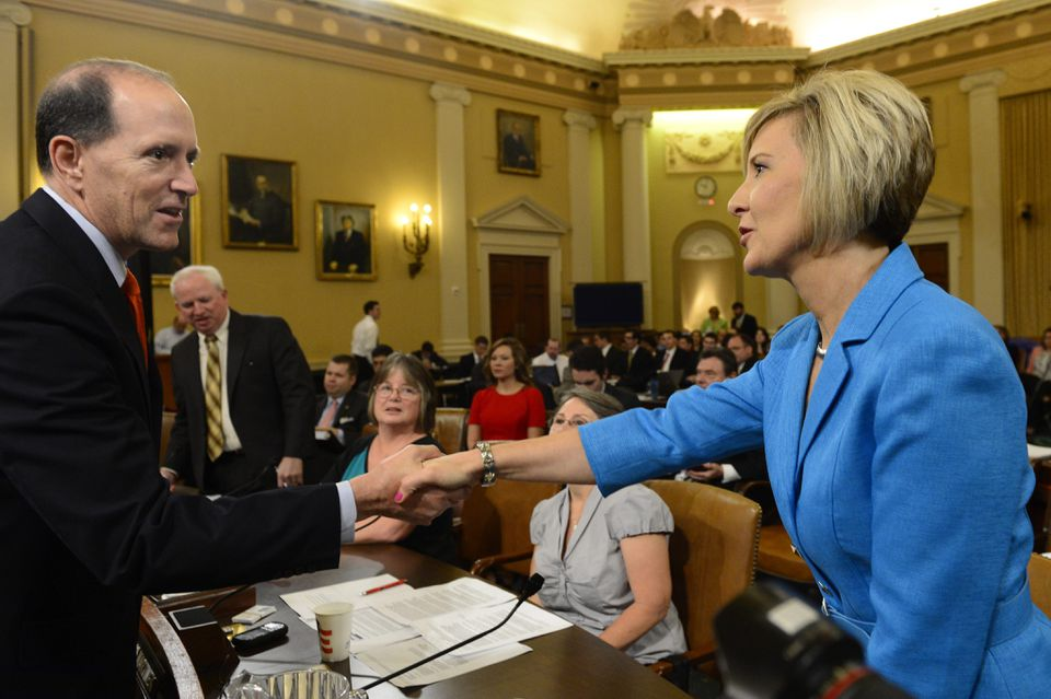 Ways and Means Committee chairman Dave Camp greeted Tea Party activist Becky Gerritson before Tuesday's hearing.