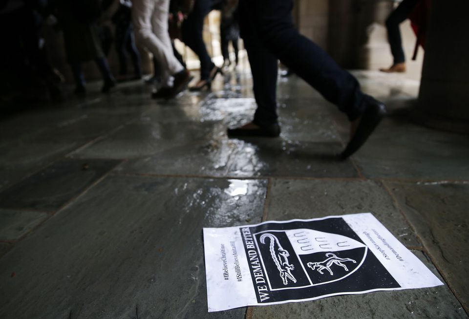 Students walked past a flier from Monday's protest against Brett Kavanaugh at Yale Law School.